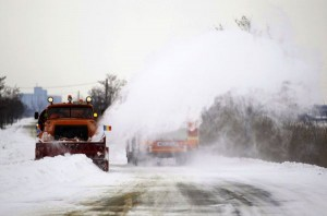 A utility vehicle clears the snow from the road near Urziceni